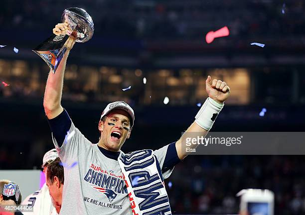 Tom Brady of the New England Patriots celebrates with the Vince Lombardi Trophy after defeating the Seattle Seahawks 2824 to win Super Bowl XLIX at...