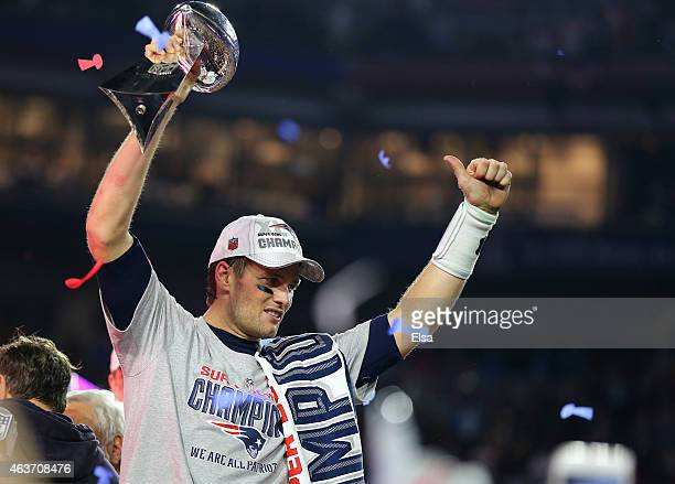 Tom Brady of the New England Patriots celebrates with the vince Lombardi Trophy after defeating the Seattle Seahawks 2824 during Super Bowl XLIX at...