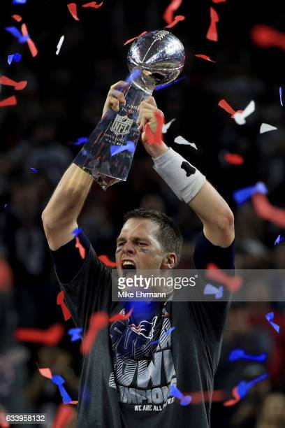 Tom Brady of the New England Patriots celebrates with the Vince Lombardi Trophy after defeating the Atlanta Falcons 3428 in overtime during Super...