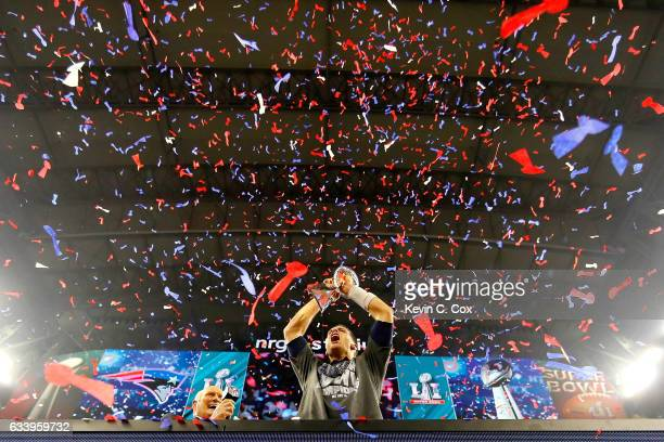 Tom Brady of the New England Patriots celebrates with the Vince Lombardi Trophy after defeating the Atlanta Falcons during Super Bowl 51 at NRG...