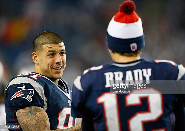 Tom Brady of the New England Patriots chats with Aaron Hernandez against the Houston Texans at Gillette Stadium on December 10 2012 in Foxboro...
