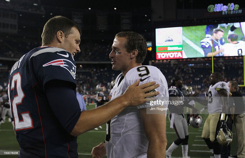 <a gi-track='captionPersonalityLinkClicked' href=/galleries/search?phrase=Tom+Brady+-+American+Football+Quarterback&family=editorial&specificpeople=201737 ng-click='$event.stopPropagation()'>Tom Brady</a> #12 of the New England Patriots chats with <a gi-track='captionPersonalityLinkClicked' href=/galleries/search?phrase=Drew+Brees&family=editorial&specificpeople=202562 ng-click='$event.stopPropagation()'>Drew Brees</a> #9 of the New Orleans Saints after preseason game at Gillette Stadium on August 9, 2012 in Foxboro, Massachusetts.
