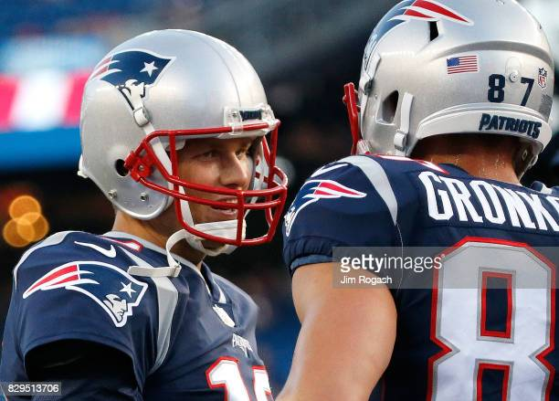 Tom Brady of the New England Patriots confers with Rob Gronkowski of the New England Patriots before a preseason game with Jacksonville Jaguars at...