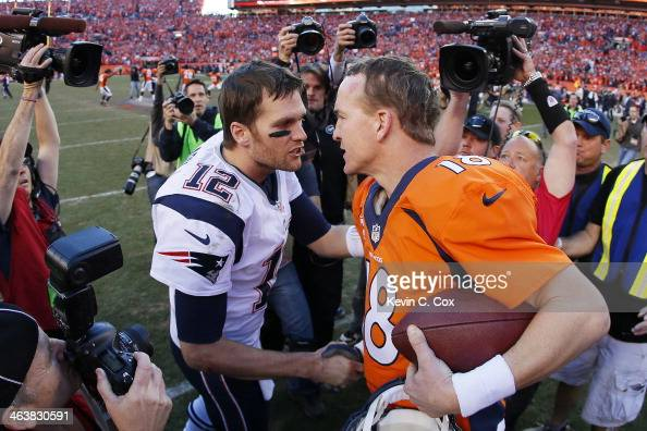 Tom Brady of the New England Patriots congratulates Peyton Manning of the Denver Broncos after the Broncos defeated the Patriots 26 to 16 during the...