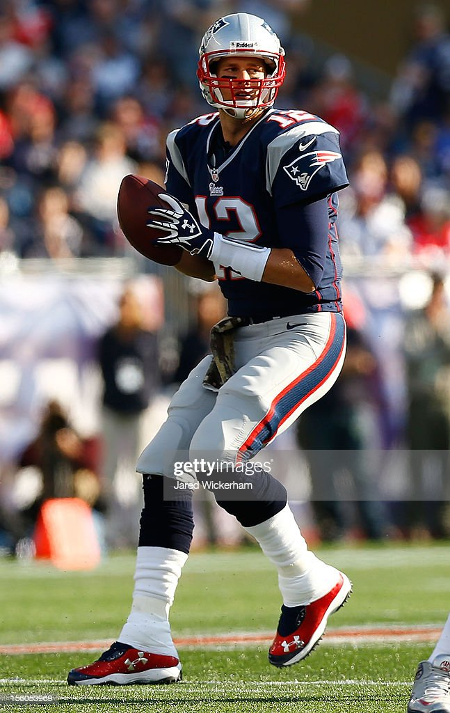 <a gi-track='captionPersonalityLinkClicked' href=/galleries/search?phrase=Tom+Brady+-+American+Football+Quarterback&family=editorial&specificpeople=201737 ng-click='$event.stopPropagation()'>Tom Brady</a> #12 of the New England Patriots drops back to pass against the Buffalo Bills during the game on November 11, 2012 at Gillette Stadium in Foxboro, Massachusetts.
