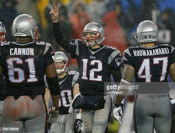 Tom Brady of the New England Patriots gestures for the twopoint conversion during a game with the Buffalo Bills in the second half at Gillette...