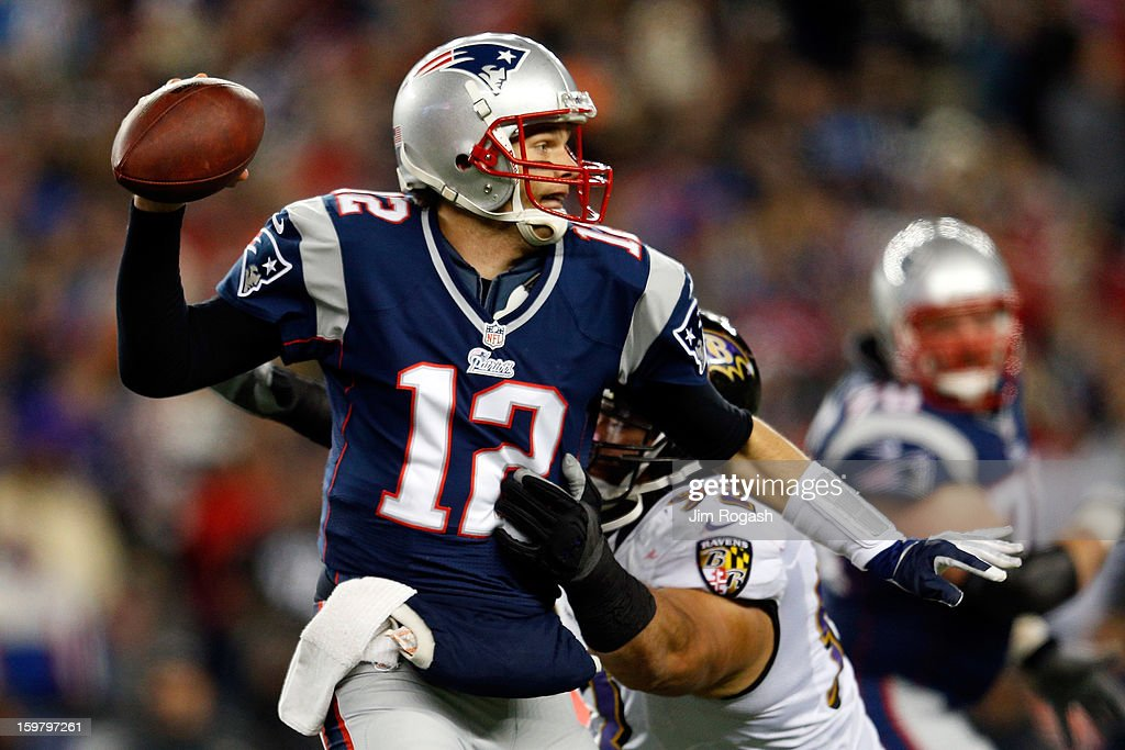 Tom Brady #12 of the New England Patriots gets pressured by Haloti Ngata #92 of the Baltimore Ravens during the 2013 AFC Championship game at Gillette Stadium on January 20, 2013 in Foxboro, Massachusetts.