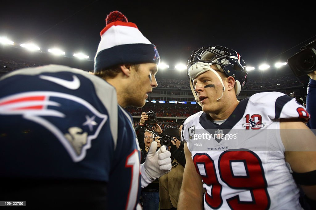 Tom Brady #12 of the New England Patriots greets J.J. Watt #99 of the Houston Texans after the 2013 AFC Divisional Playoffs game at Gillette Stadium on January 13, 2013 in Foxboro, Massachusetts.