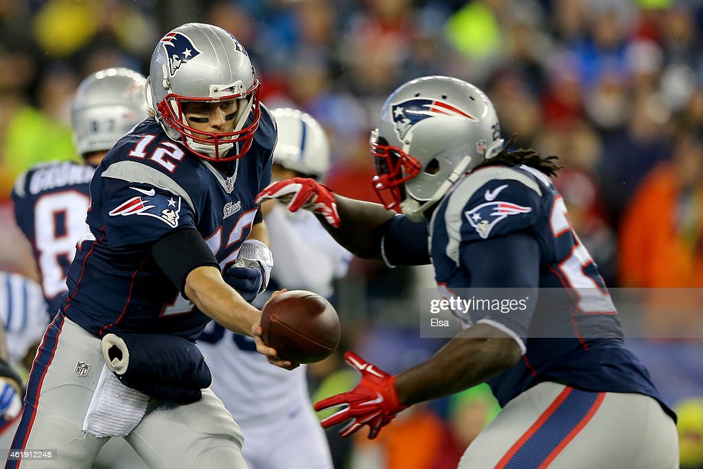 Tom Brady of the New England Patriots hands the ball off to LeGarrette Blount against the Indianapolis Colts of the 2015 AFC Championship Game at...