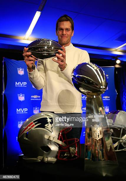 Tom Brady of the New England Patriots holds the Super Bowl XLIX MVP trophy during a Chevrolet Super Bowl XLIX MVP press conference following the...