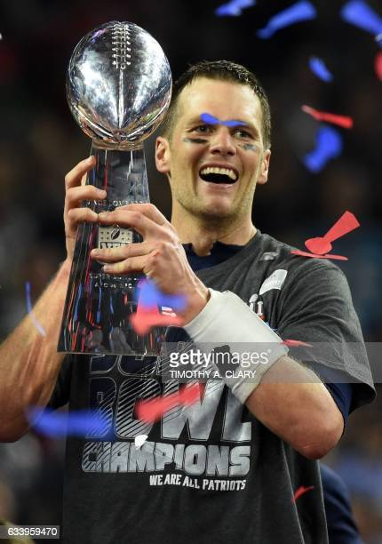 Tom Brady of the New England Patriots holds the Vince Lombardi Trophy after defeating the Atlanta Falcons 3428 in overtime during Super Bowl 51 at...