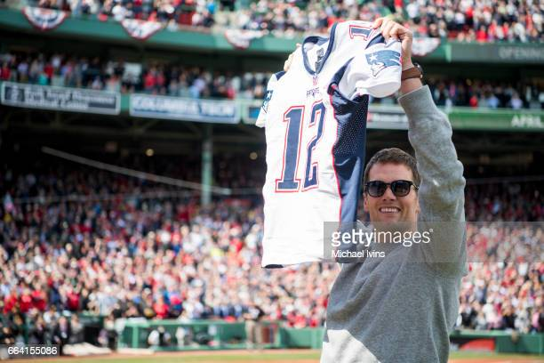 Tom Brady of the New England Patriots holds up his recovered jersey during a ceremony honoring the Super Bowl champions at Fenway Park before an...