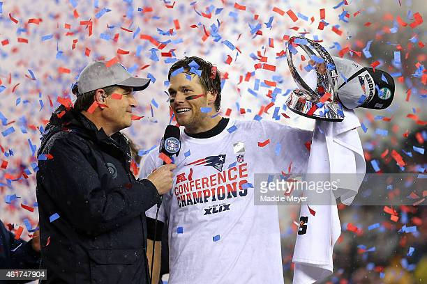 Tom Brady of the New England Patriots holds up the Lamar Hunt Trophy after defeating the Indianapolis Colts in the 2015 AFC Championship Game at...
