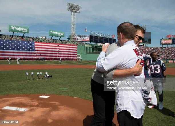 Tom Brady of the New England Patriots hugs Boston mayor Marty Walsh during a ceremony honoring the Super Bowl champions at Fenway Park before an...