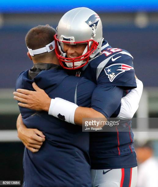 Tom Brady of the New England Patriots hugs Josh McDaniels before a preseason game with Jacksonville Jaguars at Gillette Stadium on August 10 2017 in...