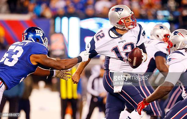 Tom Brady of the New England Patriots in action against Jasper Brinkley of the New York Giants on November 15 2015 at MetLife Stadium in East...