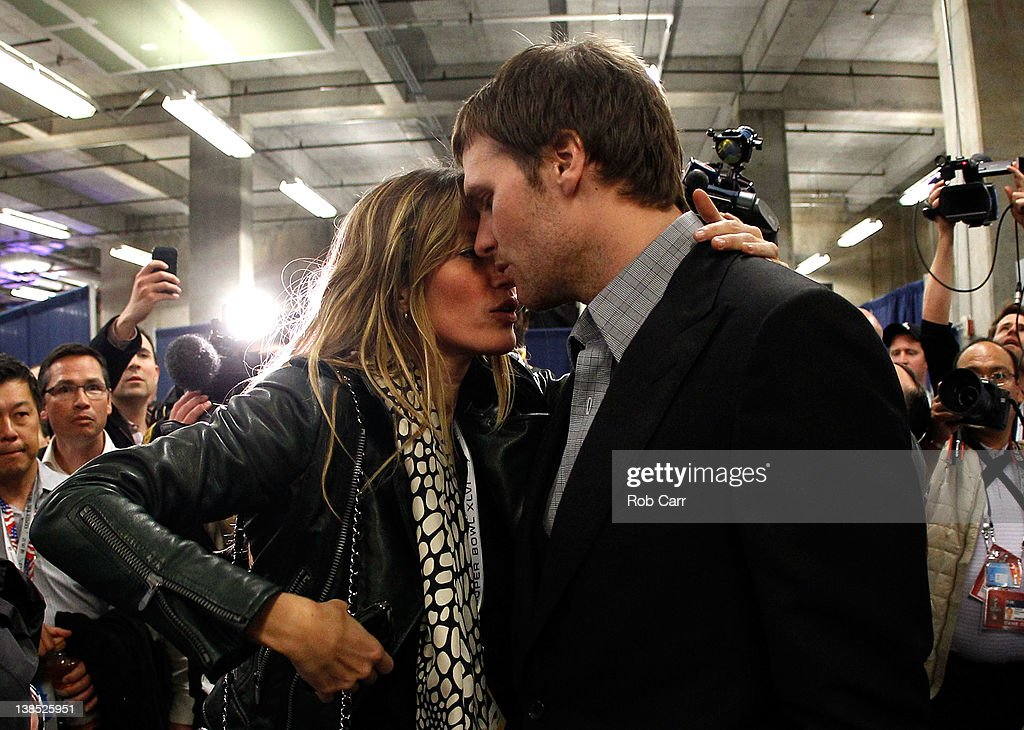 <a gi-track='captionPersonalityLinkClicked' href=/galleries/search?phrase=Tom+Brady+-+American+Football+Quarterback&family=editorial&specificpeople=201737 ng-click='$event.stopPropagation()'>Tom Brady</a> #12 of the New England Patriots is comforted by his wife <a gi-track='captionPersonalityLinkClicked' href=/galleries/search?phrase=Gisele+Bundchen&family=editorial&specificpeople=201815 ng-click='$event.stopPropagation()'>Gisele Bundchen</a> after losing to the New York Giants by a score of 21-17 in Super Bowl XLVI at Lucas Oil Stadium on February 5, 2012 in Indianapolis, Indiana.