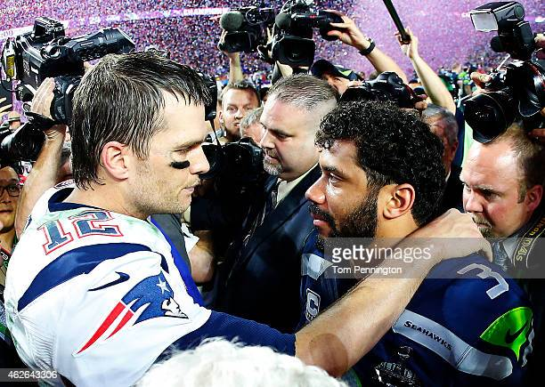 Tom Brady of the New England Patriots is congratulated by Russell Wilson of the Seattle Seahawks after Super Bowl XLIX at University of Phoenix...