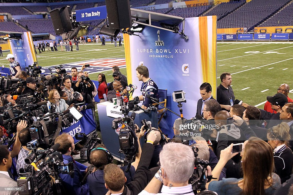 Tom Brady #12 of the New England Patriots is interviewed by Dieon Sanders of the NFL Network during Media Day ahead of Super Bowl XLVI between against the New York Giants at Lucas Oil Stadium on January 31, 2012 in Indianapolis, Indiana.