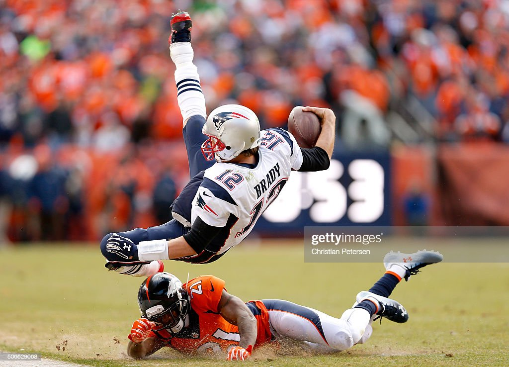 <a gi-track='captionPersonalityLinkClicked' href=/galleries/search?phrase=Tom+Brady+-+Football+americano+-+Quarterback&family=editorial&specificpeople=201737 ng-click='$event.stopPropagation()'>Tom Brady</a> #12 of the New England Patriots is tackled by <a gi-track='captionPersonalityLinkClicked' href=/galleries/search?phrase=Aqib+Talib&family=editorial&specificpeople=4037138 ng-click='$event.stopPropagation()'>Aqib Talib</a> #21 of the Denver Broncos after an 11 yard scramble in the second quarter in the AFC Championship game at Sports Authority Field at Mile High on January 24, 2016 in Denver, Colorado.