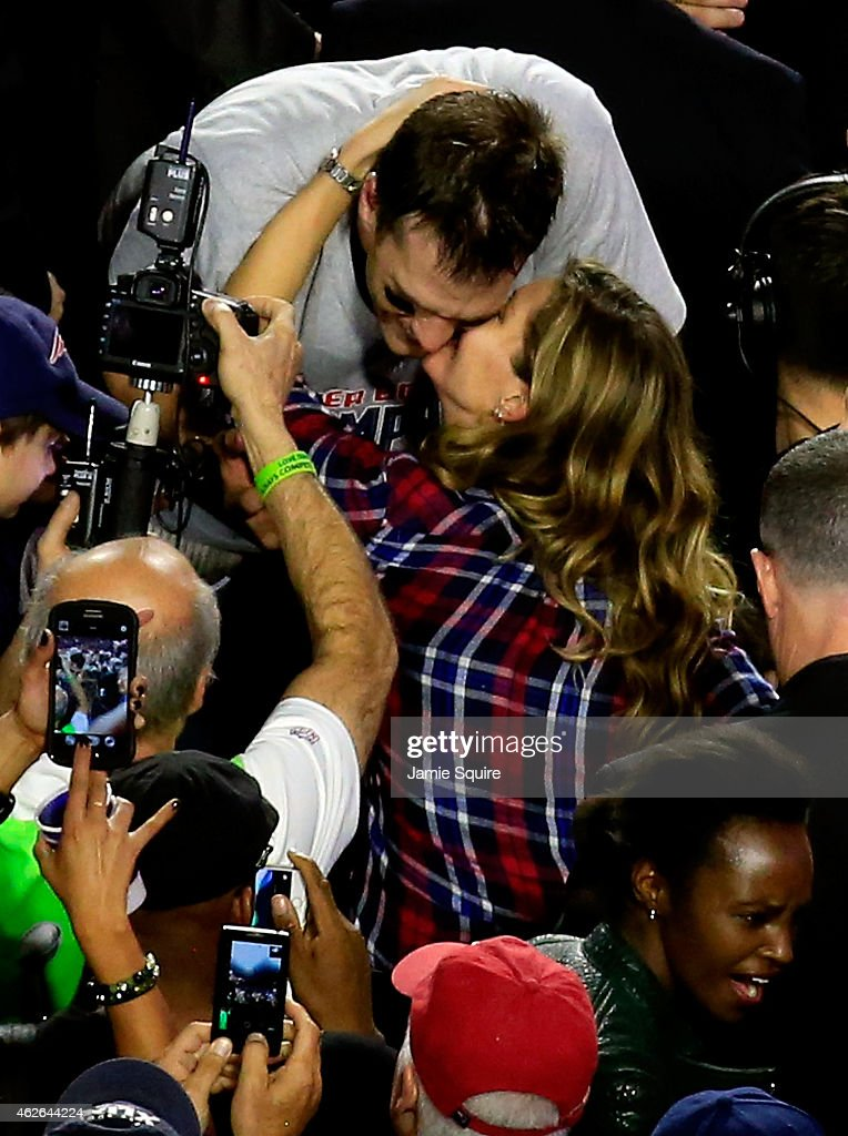 <a gi-track='captionPersonalityLinkClicked' href=/galleries/search?phrase=Tom+Brady+-+American+Football+Quarterback&family=editorial&specificpeople=201737 ng-click='$event.stopPropagation()'>Tom Brady</a> #12 of the New England Patriots kisses his wife <a gi-track='captionPersonalityLinkClicked' href=/galleries/search?phrase=Gisele+Bundchen&family=editorial&specificpeople=201815 ng-click='$event.stopPropagation()'>Gisele Bundchen</a> after defeating the Seattle Seahawks during Super Bowl XLIX at University of Phoenix Stadium on February 1, 2015 in Glendale, Arizona. The Patriots defeated the Seahawks 28-24.