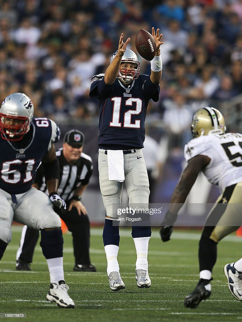 <a gi-track='captionPersonalityLinkClicked' href=/galleries/search?phrase=Tom+Brady+-+American+Football+Quarterback&family=editorial&specificpeople=201737 ng-click='$event.stopPropagation()'>Tom Brady</a> #12 of the New England Patriots leaps for high snap against the Orleans Saints in the first half at Gillette Stadium on August 9, 2012 in Foxboro, Massachusetts.