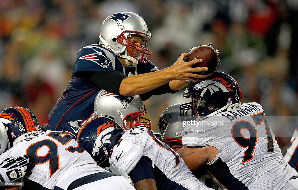 Tom Brady #12 of the New England Patriots leaps in for a touchdown in the third quarter during a game with the New England Patriots at Gillette Stadium on October 7, 2012 in Foxboro, Massachusetts.