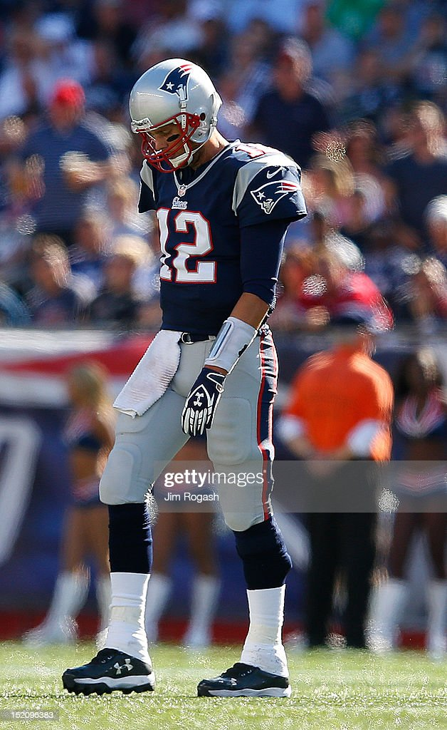 <a gi-track='captionPersonalityLinkClicked' href=/galleries/search?phrase=Tom+Brady+-+American+Football+Quarterback&family=editorial&specificpeople=201737 ng-click='$event.stopPropagation()'>Tom Brady</a> #12 of the New England Patriots leaves the field in the fourth quarter against the Arizona Cardinals at Gillette Stadium on September 16, 2012 in Foxboro, Massachusetts.