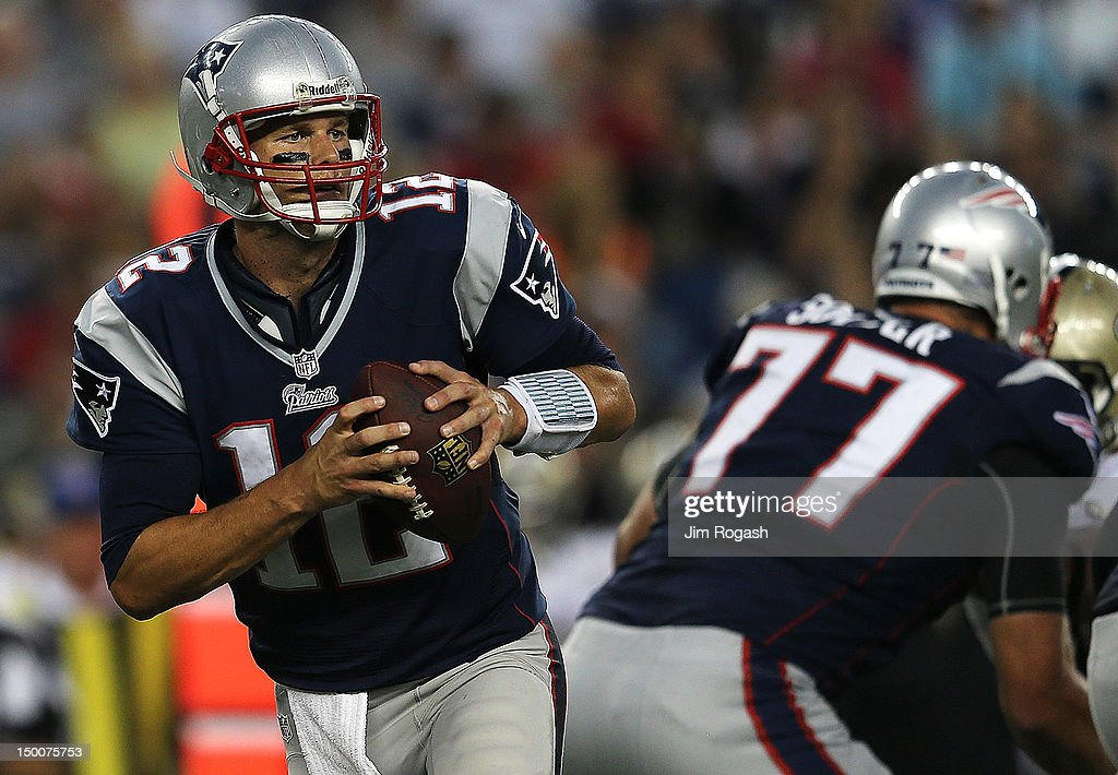 <a gi-track='captionPersonalityLinkClicked' href=/galleries/search?phrase=Tom+Brady+-+American+Football+Quarterback&family=editorial&specificpeople=201737 ng-click='$event.stopPropagation()'>Tom Brady</a> #12 of the New England Patriots looks for an open man against the New Orleans Saints in the first half at Gillette Stadium on August 9, 2012 in Foxboro, Massachusetts.