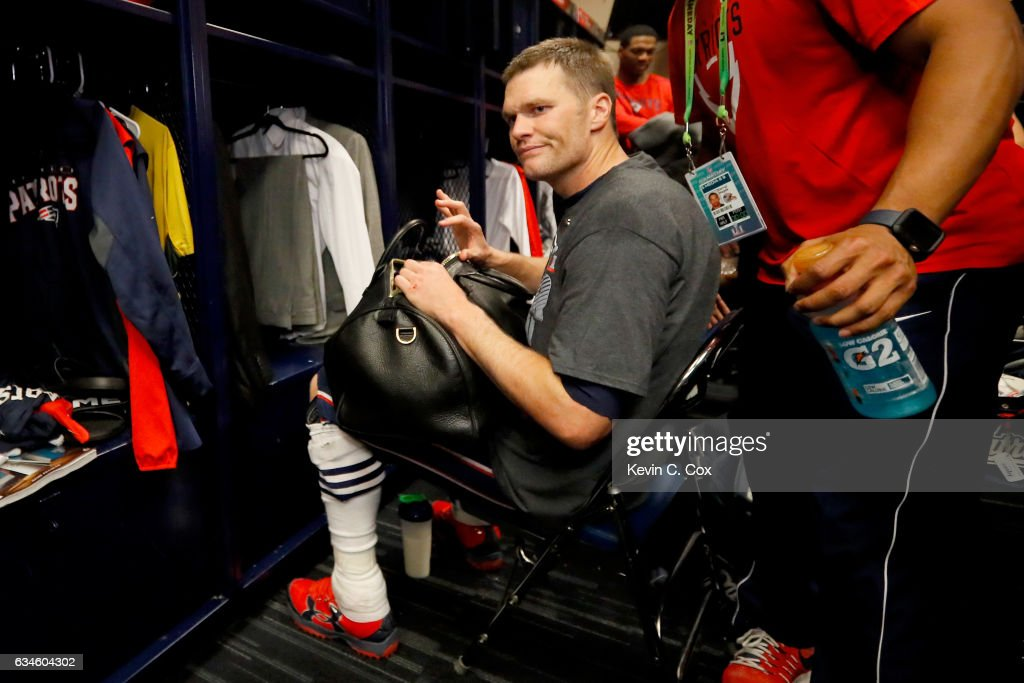 Tom Brady #12 of the New England Patriots looks for his missing jersey in the locker room after defeating the Atlanta Falcons during Super Bowl 51 at NRG Stadium on February 5, 2017 in Houston, Texas. The Patriots defeated the Falcons 34-28.