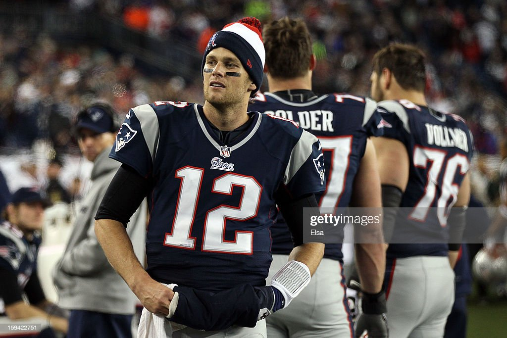 <a gi-track='captionPersonalityLinkClicked' href=/galleries/search?phrase=Tom+Brady+-+American+Football+Quarterback&family=editorial&specificpeople=201737 ng-click='$event.stopPropagation()'>Tom Brady</a> #12 of the New England Patriots looks on towards the end of the game against the Houston Texans during the 2013 AFC Divisional Playoffs game at Gillette Stadium on January 13, 2013 in Foxboro, Massachusetts.