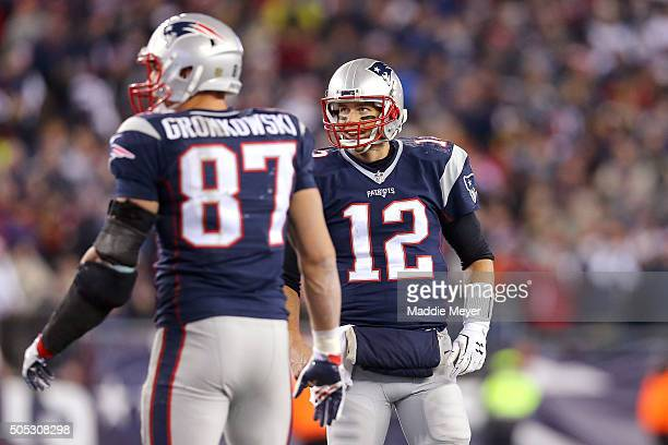 Tom Brady of the New England Patriots looks on with Rob Gronkowski in the second half against the Kansas City Chiefs during the AFC Divisional...
