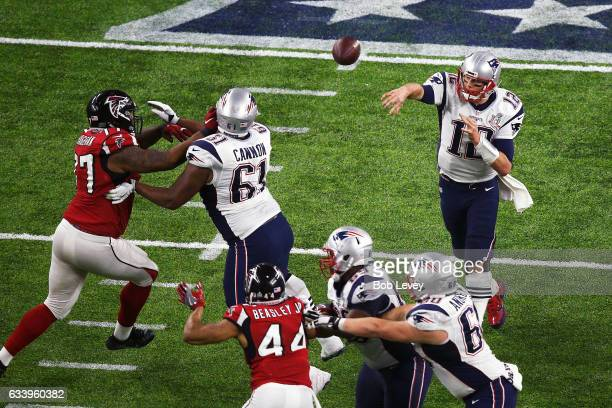 Tom Brady of the New England Patriots looks to pass against the Atlanta Falcons during the fourth quarter during Super Bowl 51 at NRG Stadium on...