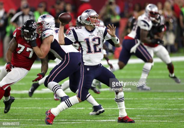 Tom Brady of the New England Patriots looks to pass in the first quarter against the Atlanta Falcons during Super Bowl 51 at NRG Stadium on February...