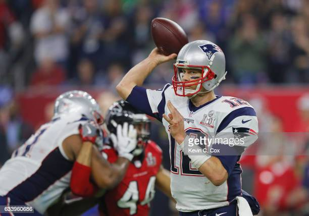 Tom Brady of the New England Patriots looks to pass late in the game against the Atlanta Falcons during Super Bowl 51 at NRG Stadium on February 5...