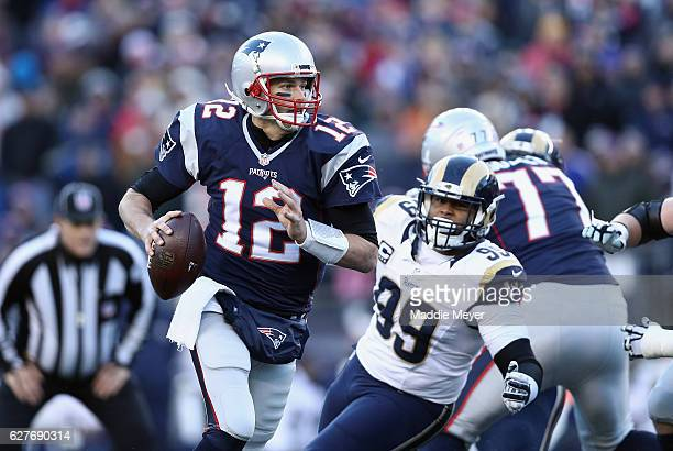 Tom Brady of the New England Patriots looks to pass the ball during the second half against the Los Angeles Rams at Gillette Stadium on December 4...