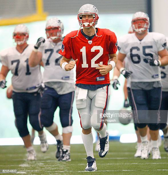 Tom Brady of the New England Patriots participates in a drill during the first day of training camp at Gillette Stadium on July 24 2008 in Foxboro...