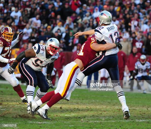 Tom Brady of the New England Patriots passes against Ryan Kerrigan of the Washington Redskins at FedEx Field on December 11 2011 in Landover Maryland