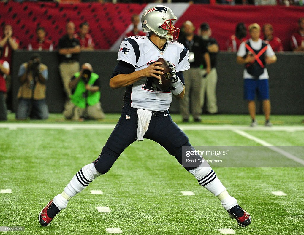 <a gi-track='captionPersonalityLinkClicked' href=/galleries/search?phrase=Tom+Brady+-+American+Football+Quarterback&family=editorial&specificpeople=201737 ng-click='$event.stopPropagation()'>Tom Brady</a> #12 of the New England Patriots passes against the Atlanta Falcons at the Georgia Dome on September 29, 2013 in Atlanta, Georgia.