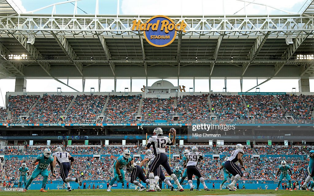 Tom Brady #12 of the New England Patriots passes during a game against the Miami Dolphins at Hard Rock Stadium on January 1, 2017 in Miami Gardens, Florida.