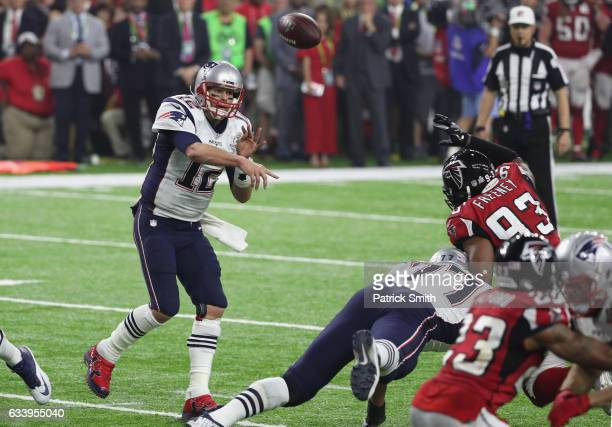 Tom Brady of the New England Patriots passes for a two point conversion late in the fourth quarter against the Atlanta Falcons during Super Bowl 51...