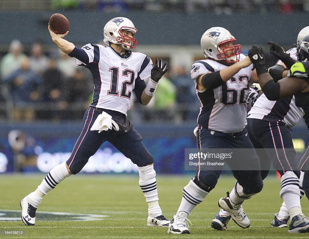 <a gi-track='captionPersonalityLinkClicked' href=/galleries/search?phrase=Tom+Brady+-+American+Football+Quarterback&family=editorial&specificpeople=201737 ng-click='$event.stopPropagation()'>Tom Brady</a> #12 of the New England Patriots passes the ball while Ryan Wendell #62 of the New England Patriots blocks during a game against the Seattle Seahawks at CenturyLink Field on October 14, 2012 in Seattle, Washington. The Seahawks beat the Patriots 24-23.