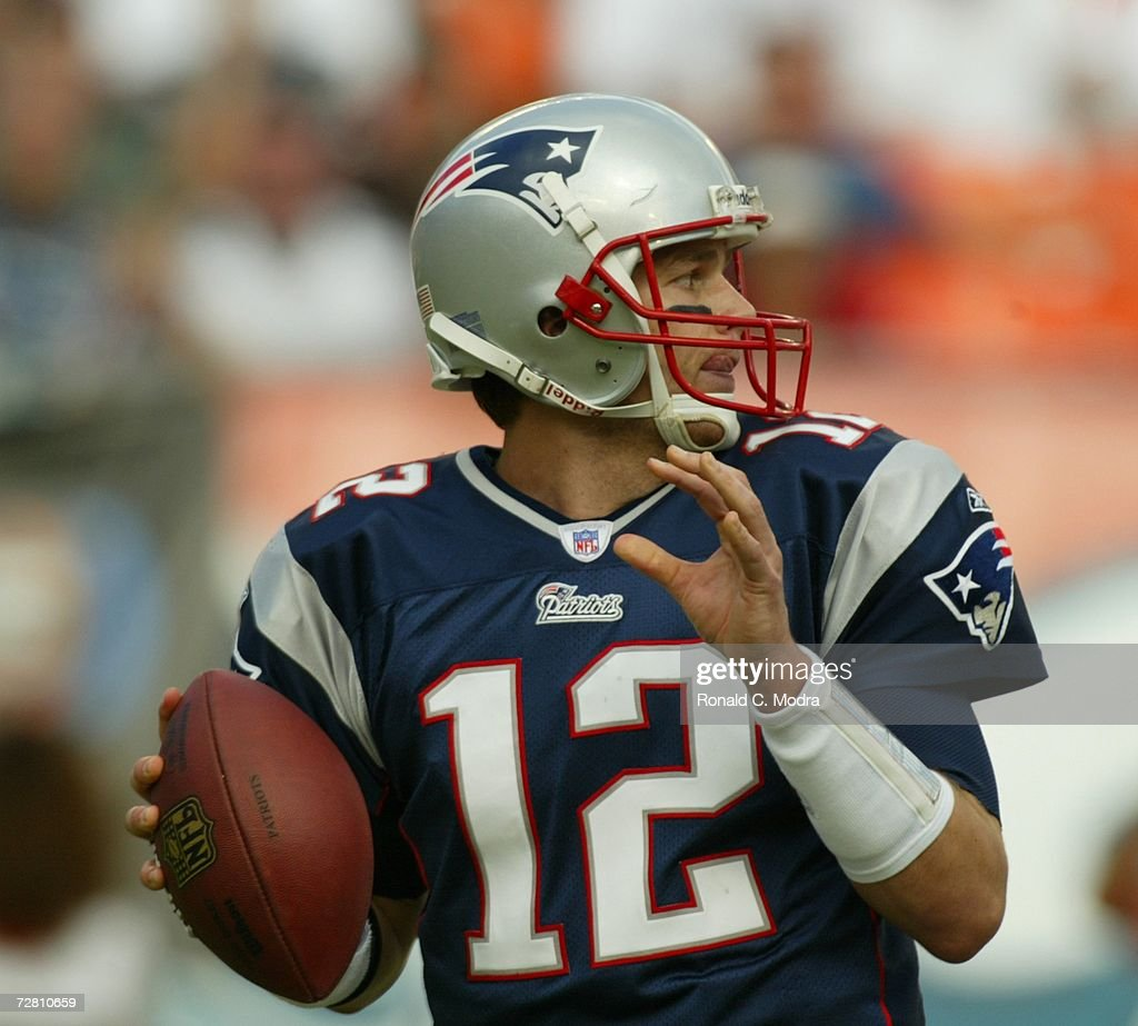 <a gi-track='captionPersonalityLinkClicked' href=/galleries/search?phrase=Tom+Brady+-+American+Football+Quarterback&family=editorial&specificpeople=201737 ng-click='$event.stopPropagation()'>Tom Brady</a> #12 of the New England Patriots passing during the NFL game against the Miami Dolphins at Dolphin Stadium on December 10, 2006 in Miami, Florida. The Dolphins defeated the Patriots 21-0.