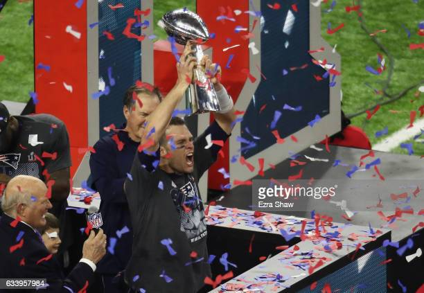 Tom Brady of the New England Patriots raises the Lombardi Trophy after defeating the Atlanta Falcons during Super Bowl 51 at NRG Stadium on February...