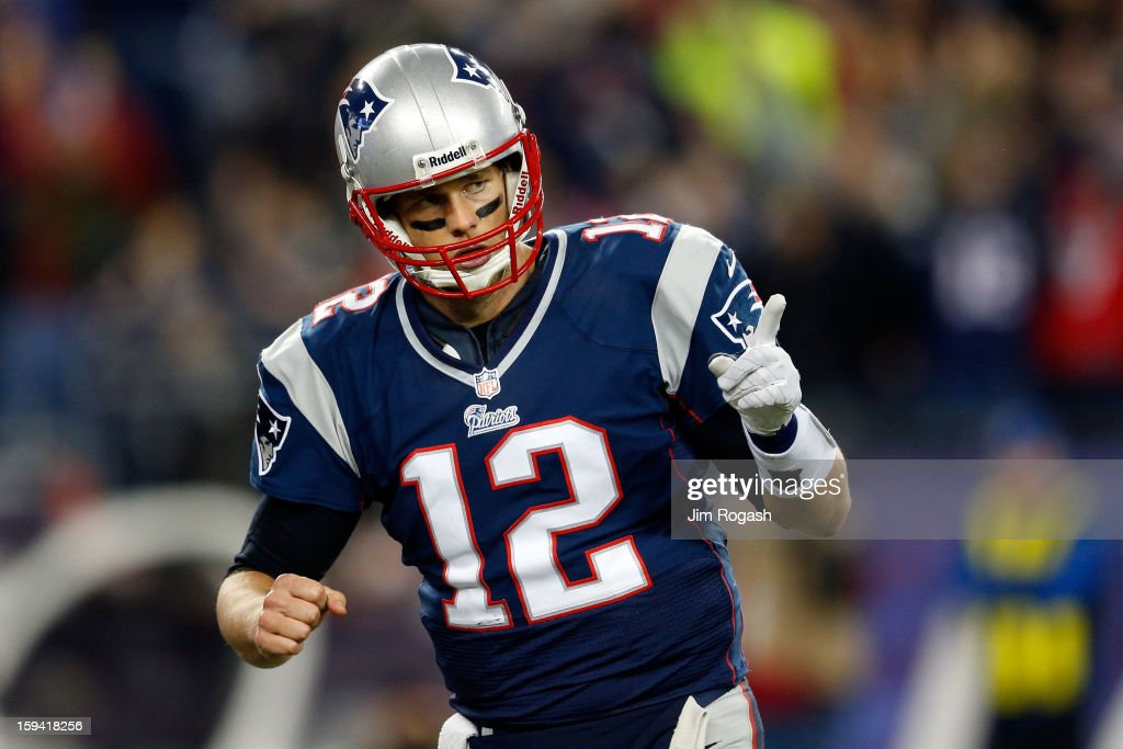 Tom Brady #12 of the New England Patriots reacts after a touchdown in the second quarter against the Houston Texans during the 2013 AFC Divisional Playoffs game at Gillette Stadium on January 13, 2013 in Foxboro, Massachusetts.