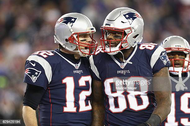 Tom Brady of the New England Patriots reacts with Martellus Bennett after scoring a touchdown during the third quarter against the Baltimore Ravens...