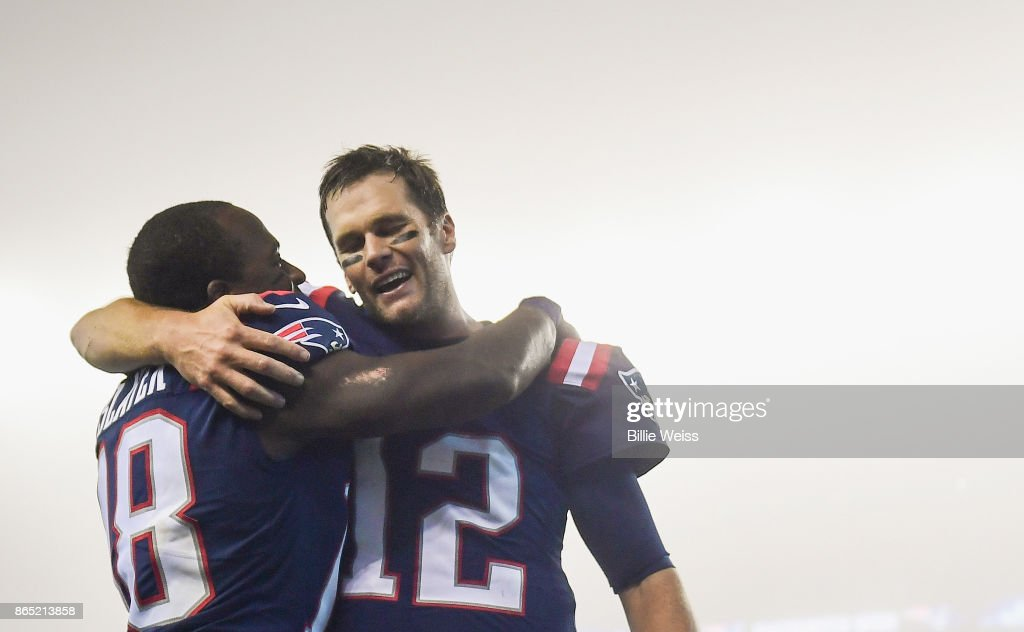 Tom Brady #12 of the New England Patriots reacts with Matthew Slater #18 after a game against the Atlanta Falcons at Gillette Stadium on October 22, 2017 in Foxboro, Massachusetts.