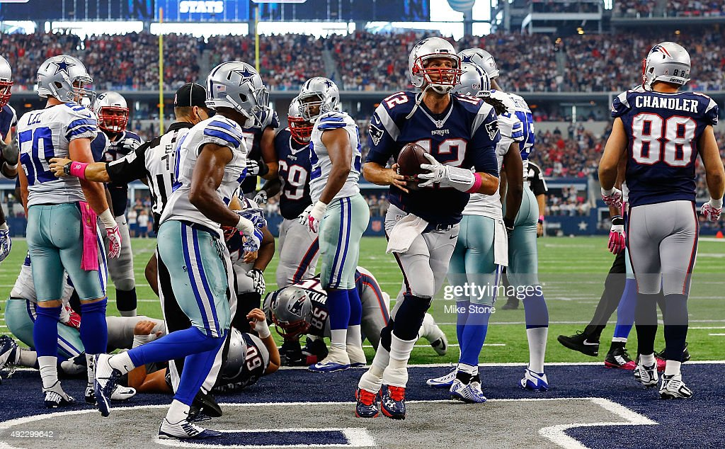 Tom Brady #12 of the New England Patriots runs for a touchdown against the Dallas Cowboys during the first half of the NFL game at AT&T Stadium on October 11, 2015 in Arlington, Texas.