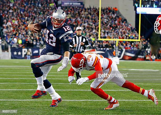 Tom Brady of the New England Patriots runs for the end zone against Husain Abdullah of the Kansas City Chiefs in the first half during the AFC...