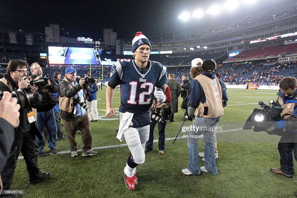 <a gi-track='captionPersonalityLinkClicked' href=/galleries/search?phrase=Tom+Brady+-+American+Football+Quarterback&family=editorial&specificpeople=201737 ng-click='$event.stopPropagation()'>Tom Brady</a> #12 of the New England Patriots runs off of the field after defeating the Houston Texans by a score of 41-28 to win the 2013 AFC Divisional Playoffs game at Gillette Stadium on January 13, 2013 in Foxboro, Massachusetts.